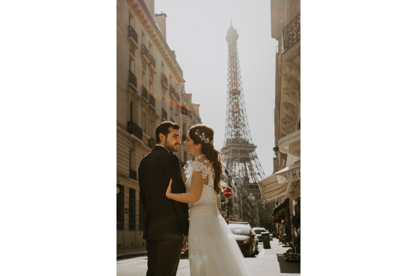 sina-demiral-sony-alpha-99II-bride-and-groom-standing-in-street-in-front-of-eiffel-tower-embracing