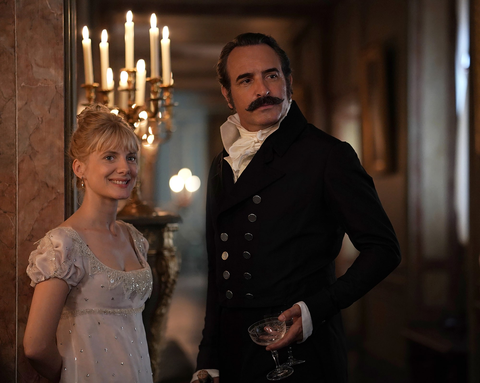 Christophe Brachet Sony Alpha 9 jean dujardin and melanie laurent dressed in formal costume in front of some candles
