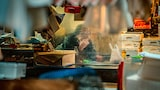 Gábor-Erdelyi-sony-shopkeeper-behind-glass-in-marketplace